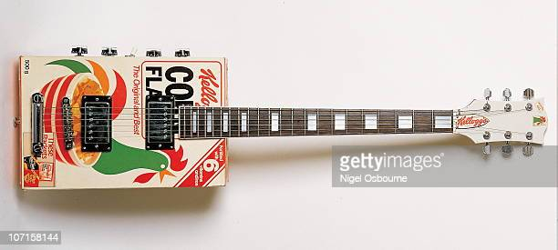 Studio still life of a 1978 Armstrong Corn Flakes novelty guitar made in the shape of a box of Kellog's Corn Flakes and owned by Simon Nicol of...