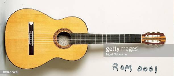 Studio still life of a 1985 Romanillos 'La Buho' classical guitar photographed in the United Kingdom
