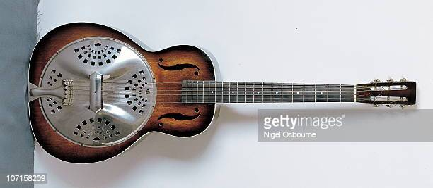 Studio still life of a 1986 Dobro f60 'F' Hole Classic resonator guitar photographed in the United Kingdom