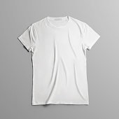 Studio template of clothes. Blank T-shirt  lies on the gray background  with shadows. Mockup  can use for you showcase.