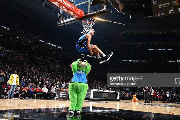 Stuff the Magic Dragon mascot holds the ball for Aaron Gordon of the Orlando Magic during the Verizon Slam Dunk Contest during State Farm AllStar...