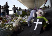Stuffed animals a cross and flowers are placed in front of Schiphol airport on July 19 two days after Malaysia Airlines flight MH17 carrying 298...