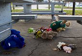 Stuffed animals flowers and a broken votive are strewn on the ground at a gazebo at Cudell Commons Park in Cleveland Ohio November 24 2014 where a...