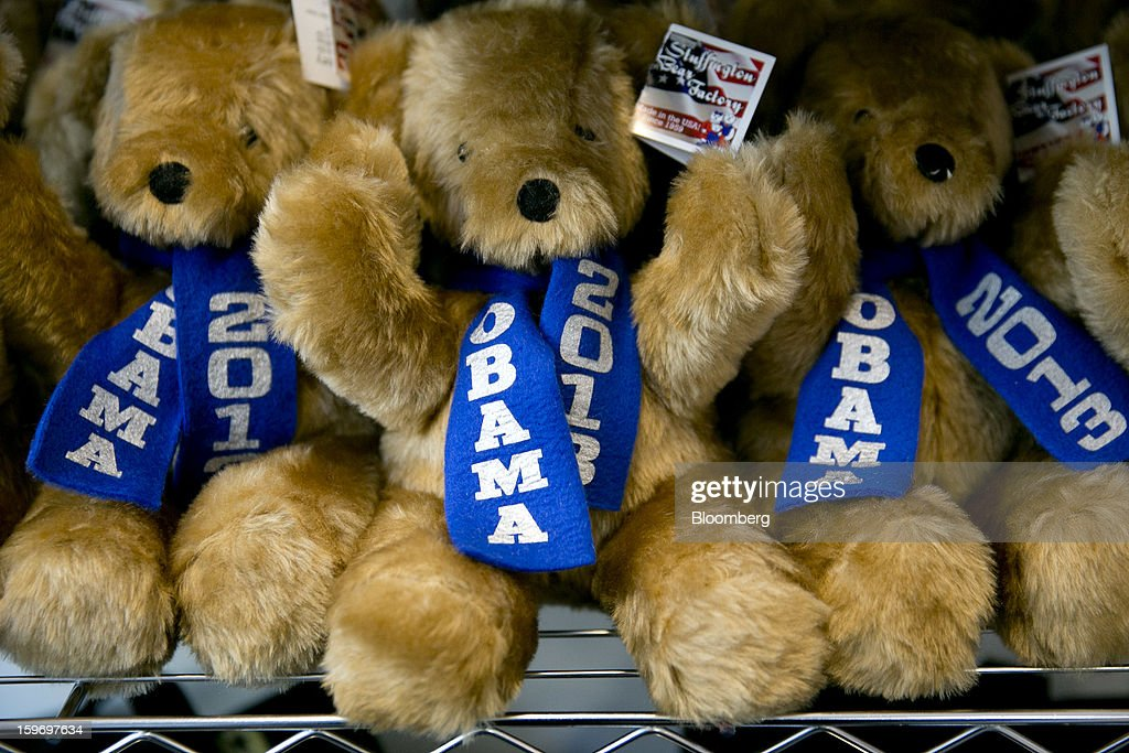 Stuffed bears with 'Obama 2013' scarves sit on display for sale at the Presidential Inaugural Committee store in Washington, D.C., U.S., on Friday, Jan. 18, 2013. President Barack Obama's second inauguration next week will combine the star power of Beyonce, Kelly Clarkson and James Taylor with a lineup that reflects social values Obama will champion in his new term. Photographer: Andrew Harrer/Bloomberg via Getty Images