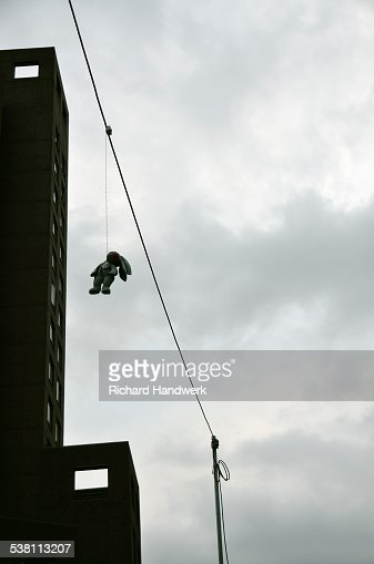 Hanging Pictures On Wire stuffed hanging bunny on wire in street stock photo | getty images