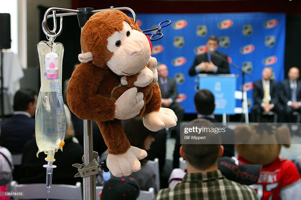 A stuffed monkey is seen in the foreground as Pat LaFontaine, President of the Companions in Courage, speaks at the podium during the Lion's Den 'Champions in Courage' North Carolina Chidren's Hospital Chapel Hill visit as part of 2011 NHL All-Star Weekend on January 28, 2011 in Raleigh, North Carolina.