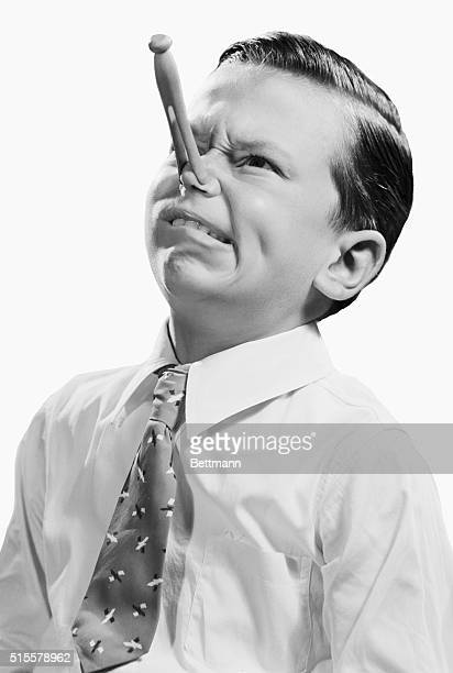 boy with clothespin on his nose simulating cold Undated B/W photograph