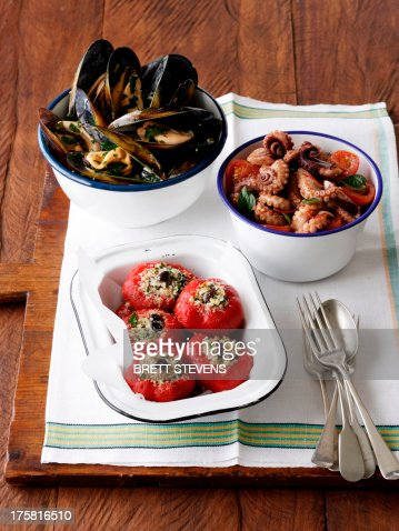 Stuffed peppers, peppered mussels and octopus : Stock Photo