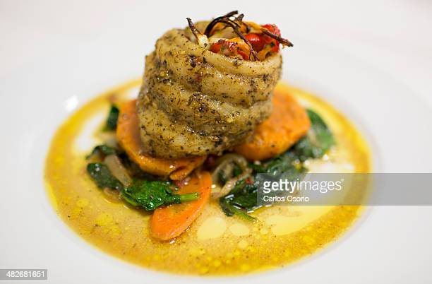 Stuffed red snapper on sauteed spinach and candied yams Jamaicanborn Toronto caterer Selwyn Richards launches his first cookbook 'The Art of Cooking...