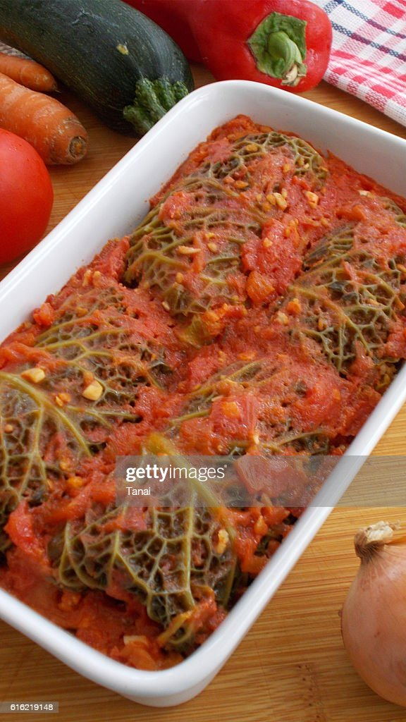 Stuffed savoy cabbage rolls in tomato sauce : Stock Photo