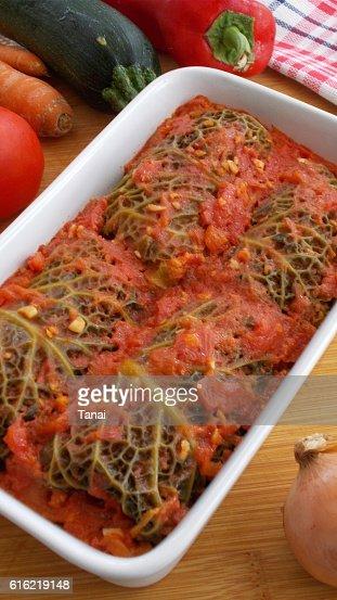 Stuffed savoy cabbage rolls in tomato sauce : Stock Photo