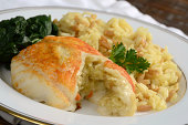 Sole filet stuffed with crabmeat served with rice pilaf and sauteed spinach.