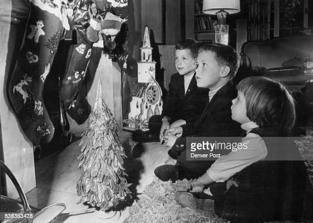 Stuffed stockings in home of Mr and Mrs Thomas Francis get undivided attention of their children Lee Sandy and Debbie from left Credit Denver Post