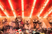Stuffed toy bears on display awarded as winning prizes at Christmas funfair winter wonderland