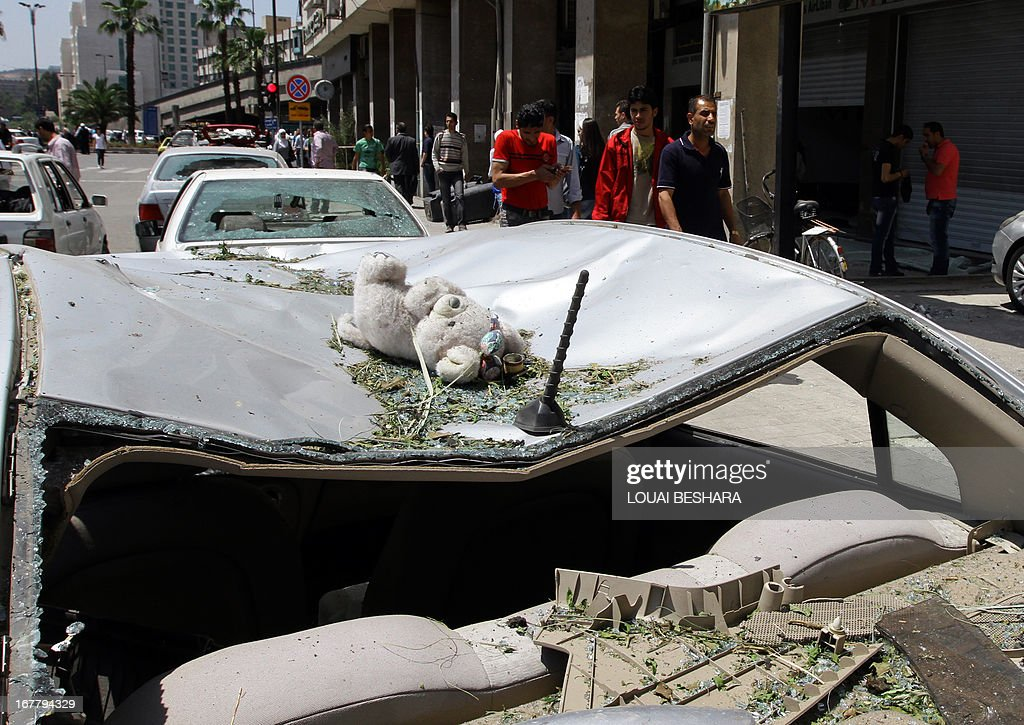 A stuffed toy is seen on the roof of a damaged vehicle following a blast in the Marjeh district of Damascus, on April 30, 2013. The blast killed at least 13 people, Syrian state television reported, a day after a Prime Minister Wael al-Halqi survived a bomb attack elsewhere in the capital.