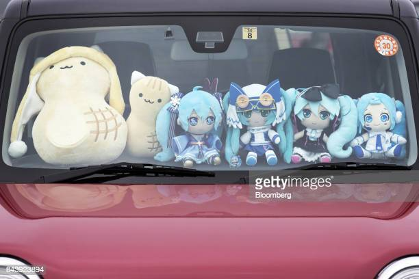 Stuffed toys of Hatsune Miku a virtual pop star and the voice behind Crypton Future Media Inc's vocal synthesizer softwareare displayed at the...