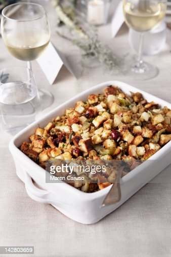 Stuffing and wine glasses on table