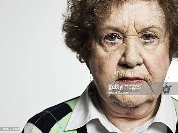 Stuido portrait of serious senior woman