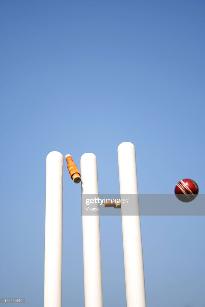 Stumps disturbed by a cricket ball