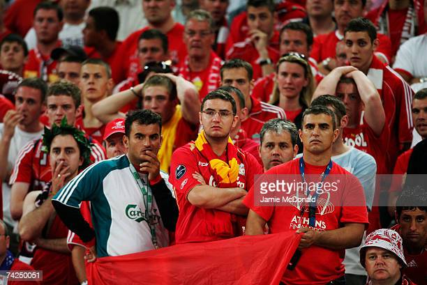 Stunned Liverpool fans look on following their team 21 defeat during the UEFA Champions League Final match between Liverpool and AC Milan at the...