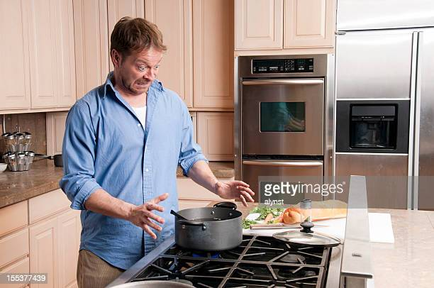 Stunned Man Cooking in His Kitchen