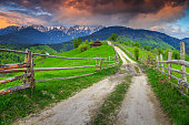 Spectacular summer alpine landscape with green fields and high snowy mountains,Bran,Transylvania,Romania,Europe