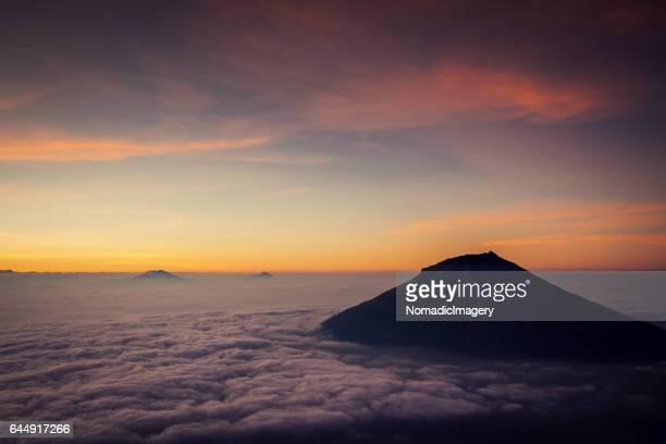 Stunning daybreak colours silhouette mount Sumbing Volcano
