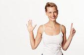 Beautiful woman holding up six fingers, portrait