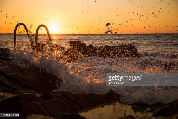 Stunning swimming pool in the Costa Brava Mediterranean Sea between the rocks close to Mediterranean Sea with sunrise light.