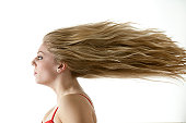 Stunning teenage girl with extreme blowing long blonde hair