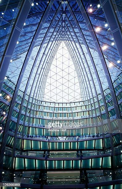 A stunning view up the central glass atrium of The Point at Paddington Basin. The Point is a 13 level structure on a curved site at the north of the basin adjacent to Paddington Station, which has a direct link by way of a footbridge. The building offers a