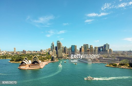 Stunning wide angle aerial drone view of the Sydney Harbour with the Opera House, a cruise ship and many skyscrapers in the background. Taken near the suburb of Kirribilli. New South Wales, Australia. : Stock Photo