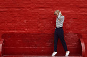 Stunning young woman against red wall