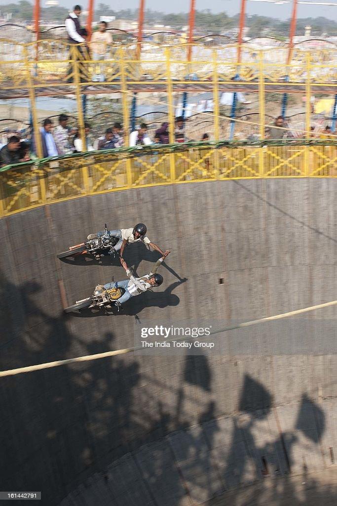 Stunt bikers performing at the Kumbh Mela in Allahabad.