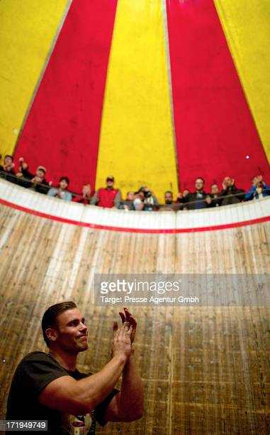 A stunt driver applaudes the audience after his performance at the so called 'Wall of Death' during the 'Roadrunners Paradise and Race festival' 2013...