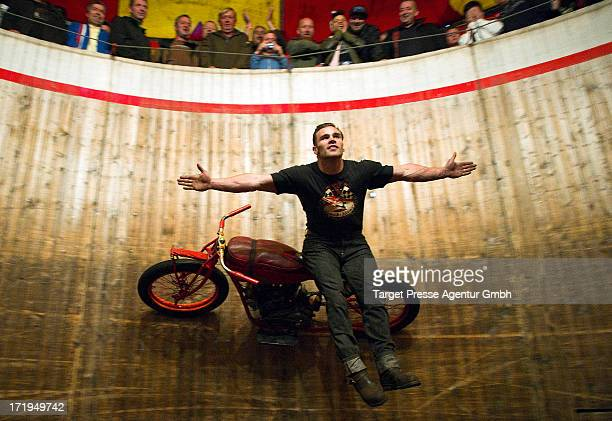 A stunt driver performs on his motorbike at the so called 'Wall of Death' during the 'Roadrunners Paradise and Race festival' 2013 on June 29 2013 in...