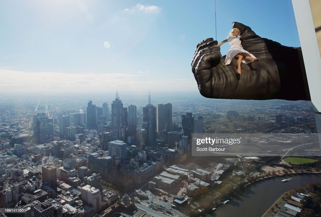 Stunt expert Leigh-Anne Vizer is held by a 4.5 metre King Kong hand 300 metres above the city of Melbourne during a 'King Kong' production photo call at Eureka Skydeck on May 21, 2013 in Melbourne, Australia. Eureka Skydeck gave permission for the construction of the large Kong hand to offer visitors the King Kong Experience at Eureka Sydeck over the next 9 months. The King Kong show is set to open in June in Melbourne and Eureka observation deck is the highest public vantage point on a buliding in the southern hemisphere.