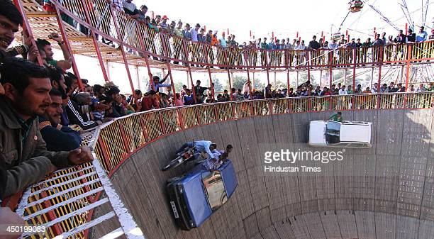 Stunt men ride their cars as they display their skills during the famous Jhiri fair a village where 'blessed peasant Jitu' scarified his life...