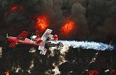 Stunt pilots Melissa Pemberton Jurgis Kairys and Skip Stewart of The Immortals fly past pyrotechnics as they perform at The Australian International...