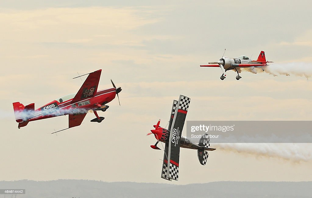 Stunt pilots Melissa Pemberton Jurgis Kairys and Skip Stewart of The Immortals fly past pyrotechnics as they perform at The Australian International...