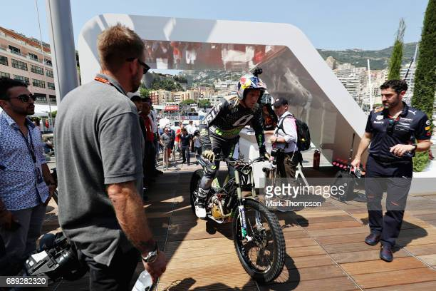 Stunt rider Dougie Lampkin performs a show on the Red Bull Racing Energy Station during the Monaco Formula One Grand Prix at Circuit de Monaco on May...