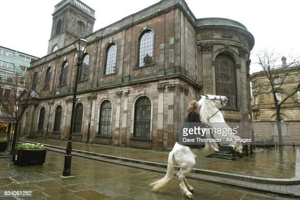 Stunt rider Emily Cox posing as Lady Godiva riding Legend through St Ann's Square Manchester