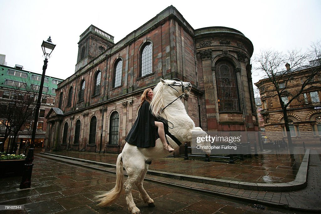 Stunt rider Emily Cox rides her horse Legend through St Ann's Square recreating the historical ride of Lady Godiva on January 18 2008 in Manchester...
