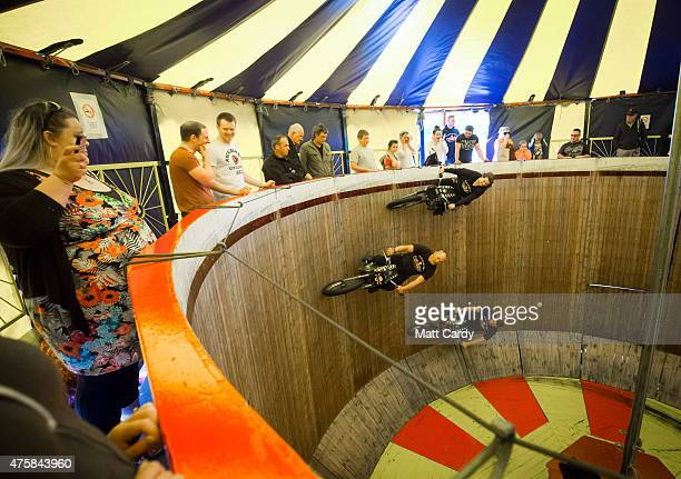 Stunt riders perform on the Wall of Death an attraction at the Royal Cornwall Show on the opening day of the show near Wadebridge on June 4 2015 in...