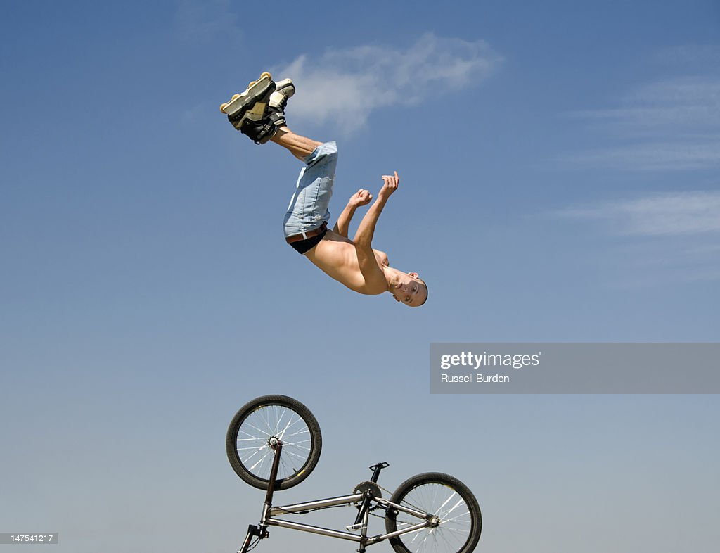 stunt skater performing aerials : Stock Photo