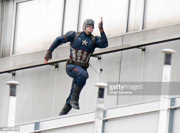 A stuntman dressed as Captain America is seen during filming on the set of Captain America Civil War on August 12 2015 in Berlin Germany