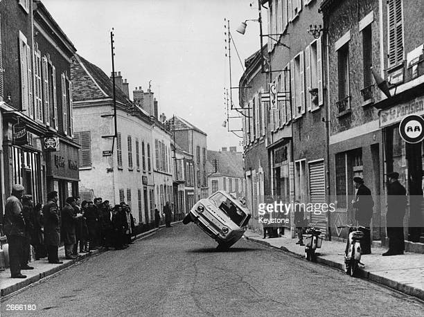 Stuntman Jean Sunny attempts to beat his personal record of driving at 95km on two wheels Spectators line the streets of a French village on his...