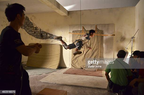 A stuntman practicing a jump on the Hong Kong film set of Rigor Mortis a horror film about vampires The film is Juno Mak's directorial debut and is...