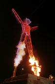 Stuntman Ted Batchblor sets himself on fire as he ignites the neonlit Burning Man statue on the last night of the weeklong 'Burning Man Festival' 06...