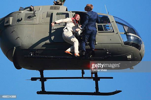 Stuntmen perform a battle hanging from a helicopter during the filming of the latest James Bond movie 'Spectre' at downtown streets of Mexico City on...